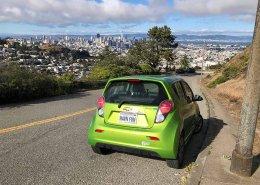 Green zippy car with San Francisco downtown