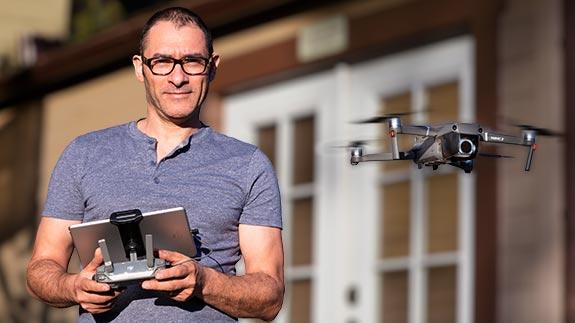 Daniel Gamburg flies a drone