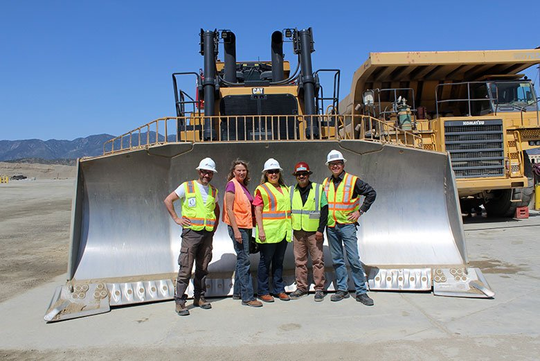 Video Crew in front of giant bulldozer