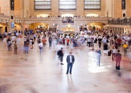 Man standing in the middle of Grand Central Station in NYC
