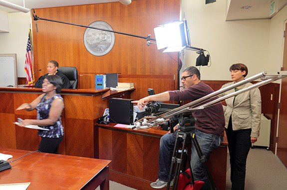 Video production in a courtroom.
