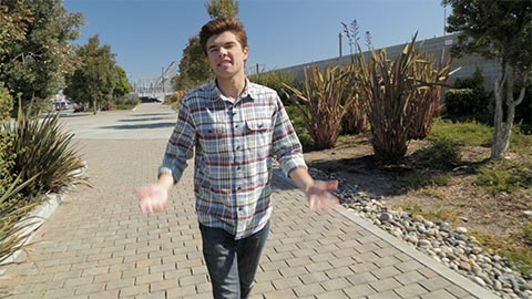 Nick narrating a video while walking